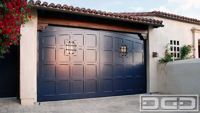 Spanish colonial carriage garage doors custom crafted in for Composite wood garage doors