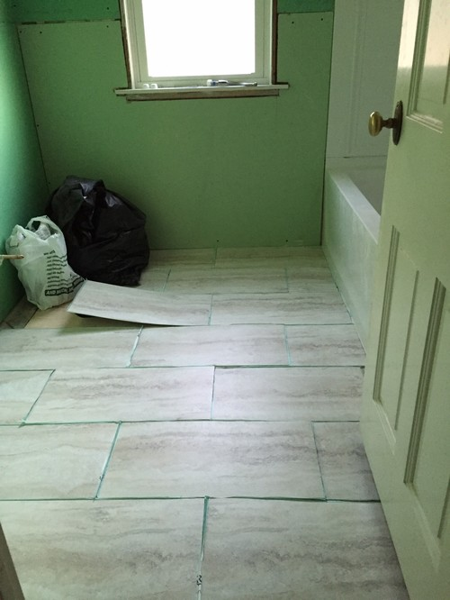 Which direction should i lay the 12x24 vinyl tiles in our for Bathroom 12x24 tile