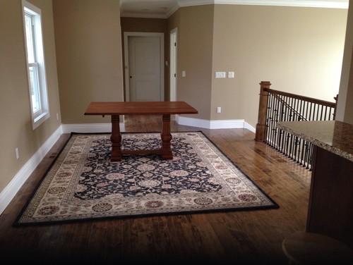 Round dining tablerectangular rug