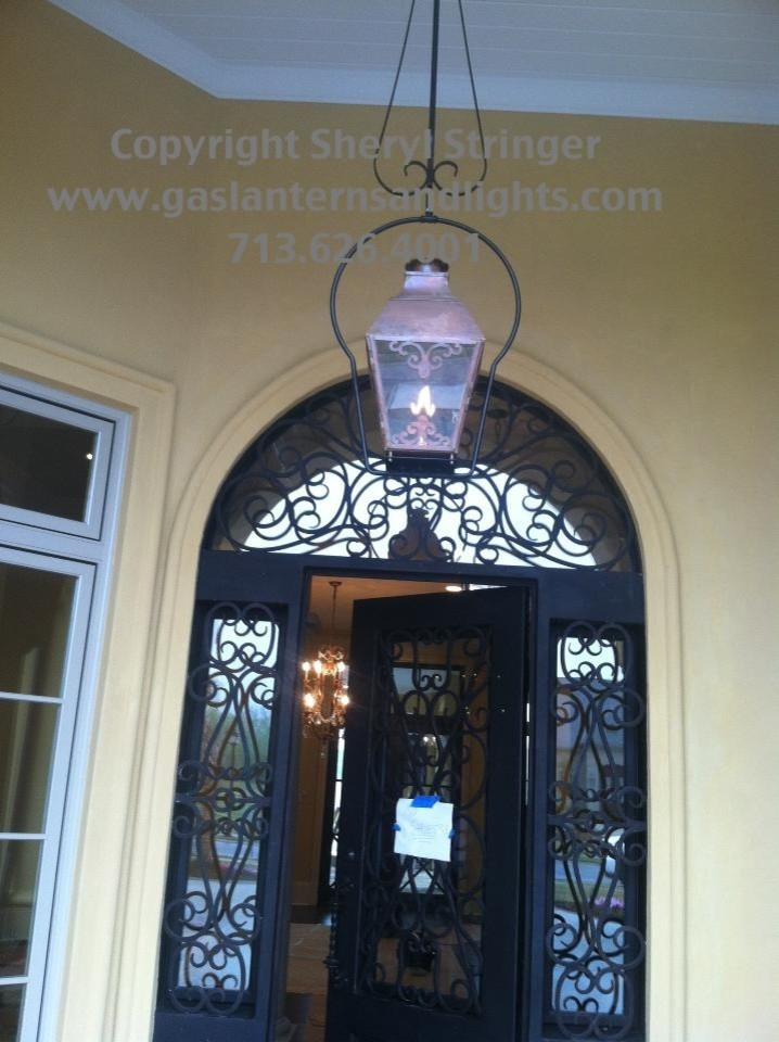 Sheryl's French Style Gas Lantern with Solid Top, Window Pane Scrolls and Hangin