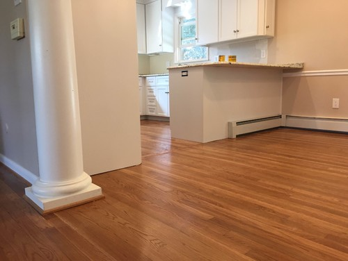 Kitchen remodel: shoe molding to match cherry floor or white cabinets?
