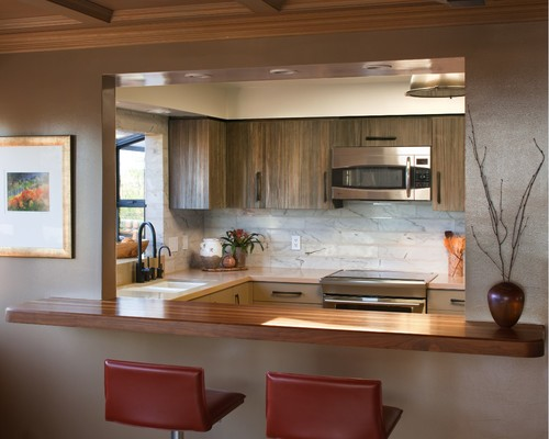 To ensure the cooks in the kitchen are always connected to for Kitchen window bar ideas