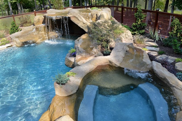 Faux Rock Grotto With Waterfall Into Gunite Pool Spa With