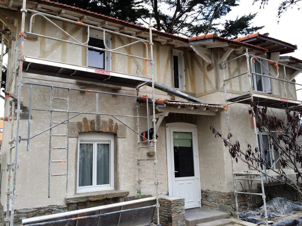 Restauration de façade ancienne, esprit colombages