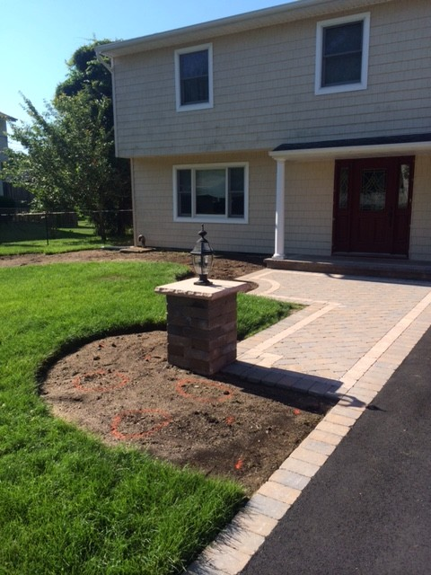 Driveway and creative walkway with light pier for Creative home designs llc
