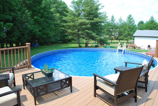 Radiant round above ground pool with composite deck transitional pool detroit by pools - Above ground composite pool deck ...