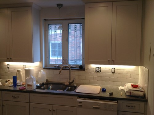Kitchen Backsplash Uneven Wall subway tile looks uneven under cabinet lighting