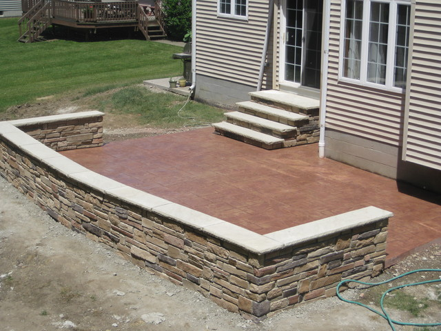 Grand Ashlar Stamped Patio W Cultured Stone Seating Wall