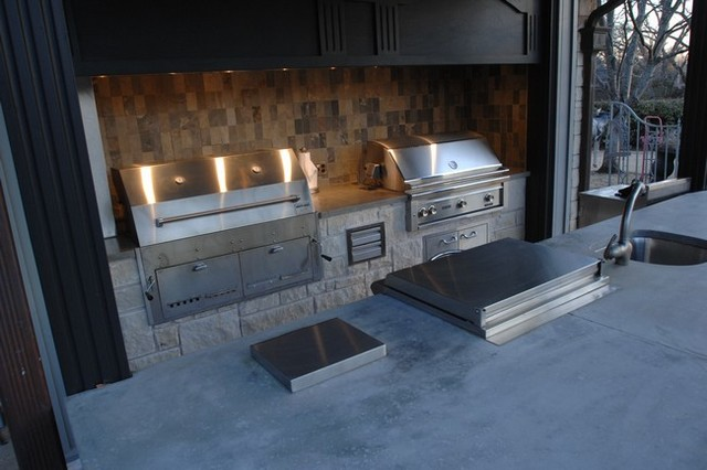 Outdoor Kitchen With Clean Concrete Countertops With Charcoal And Gas  Grills Industrial