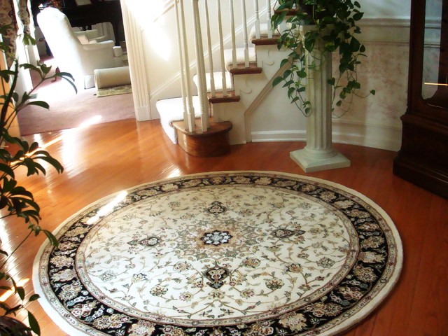 Round Rug With Curved Staircase Traditional Entrance