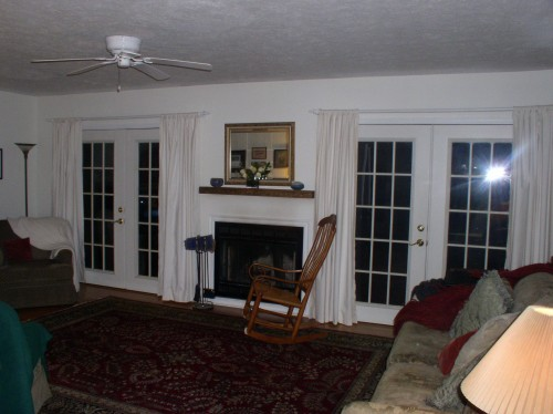 How Do I Arrange Furniture In A Living Room With Multiple Focal Points We Have Two French Doors That Are On Either Side Of A Fireplace We Have An