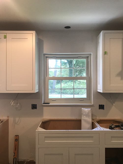 how to tile around kitchen cabinets tile or not around window above kitchen sink 17411
