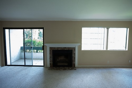Weird Condo Wall With Fireplace Window Sliding Patio Door