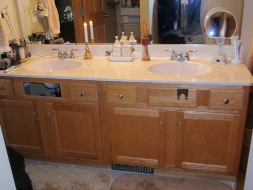 Framed the master bath mirror, and gel stained the cabinets dark