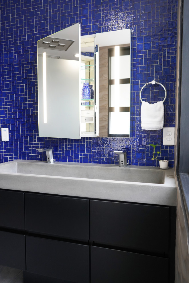 Inspiration for a mid-sized contemporary master blue tile and glass tile porcelain tile, gray floor and double-sink bathroom remodel in Atlanta with flat-panel cabinets, black cabinets, a bidet, gray walls, a trough sink, concrete countertops, gray countertops and a floating vanity