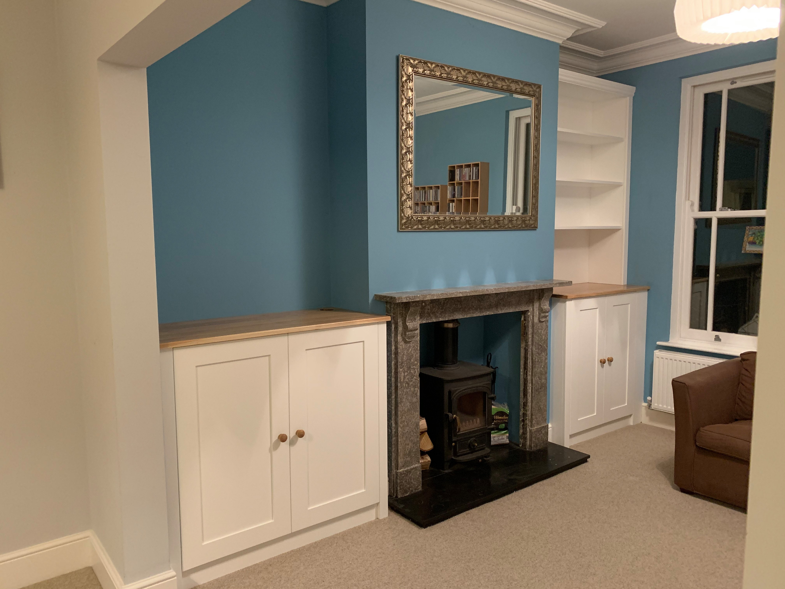 Shaker Style Alcove Cabinets with Oak Tops and a Bookcase