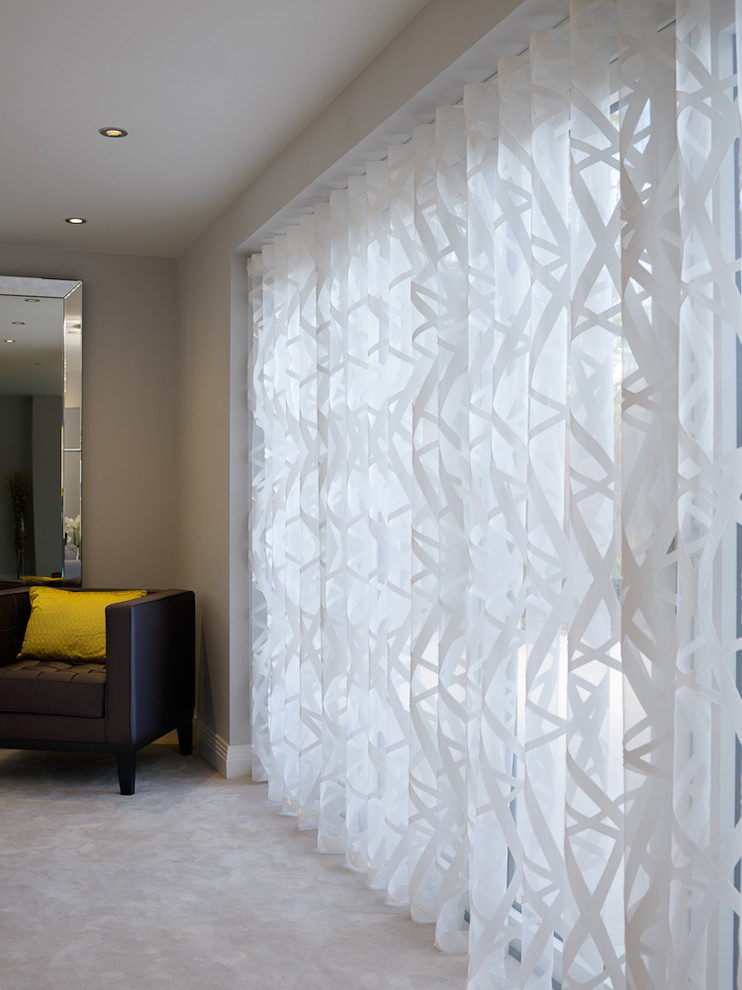 Example of a trendy home design design in Surrey