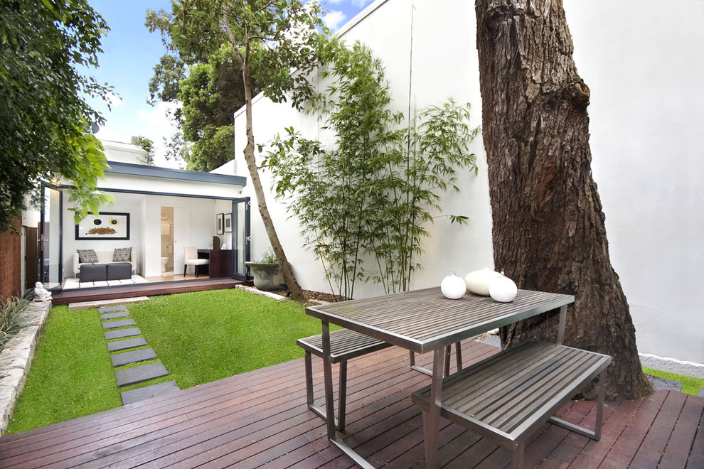 Inspiration for a contemporary patio remodel in Sydney with decking