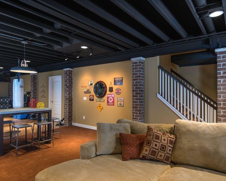 Inspiration for a contemporary orange floor basement remodel in Detroit