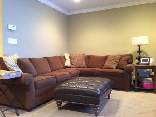 wall decorations above l shaped sectional couch. Black Bedroom Furniture Sets. Home Design Ideas