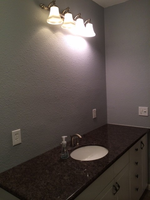 Bathroom Lights Above Sink need help - center a bathroom light over sink or cabinet?