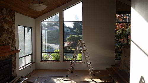 What kind of window covering for floor to ceiling angled - What are floor to ceiling windows called ...
