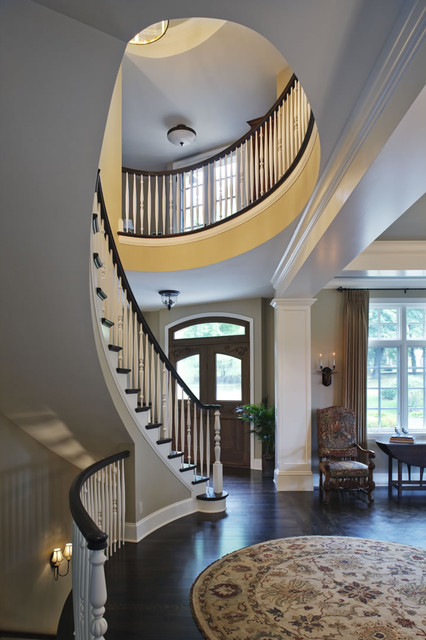 Curved Stairway And Front Door