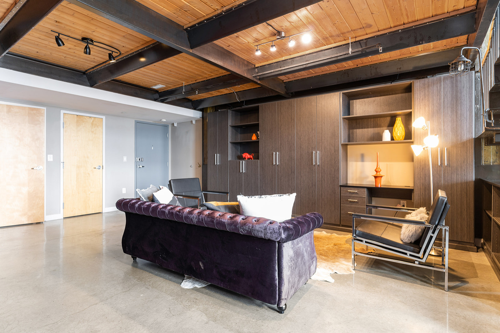 Large Wall unit installed in Philadelphia loft home which also includes a small desk space.