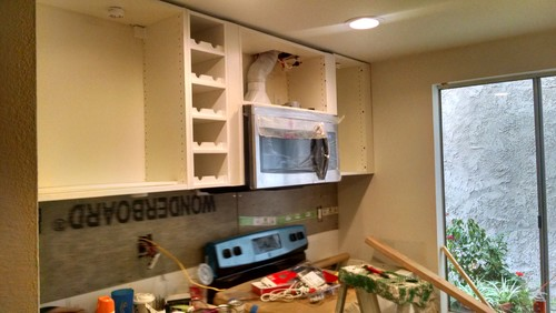 Kitchen Backsplash Uneven Wall how can i conseal a wall kitchen cabinet that's uneven on the top?