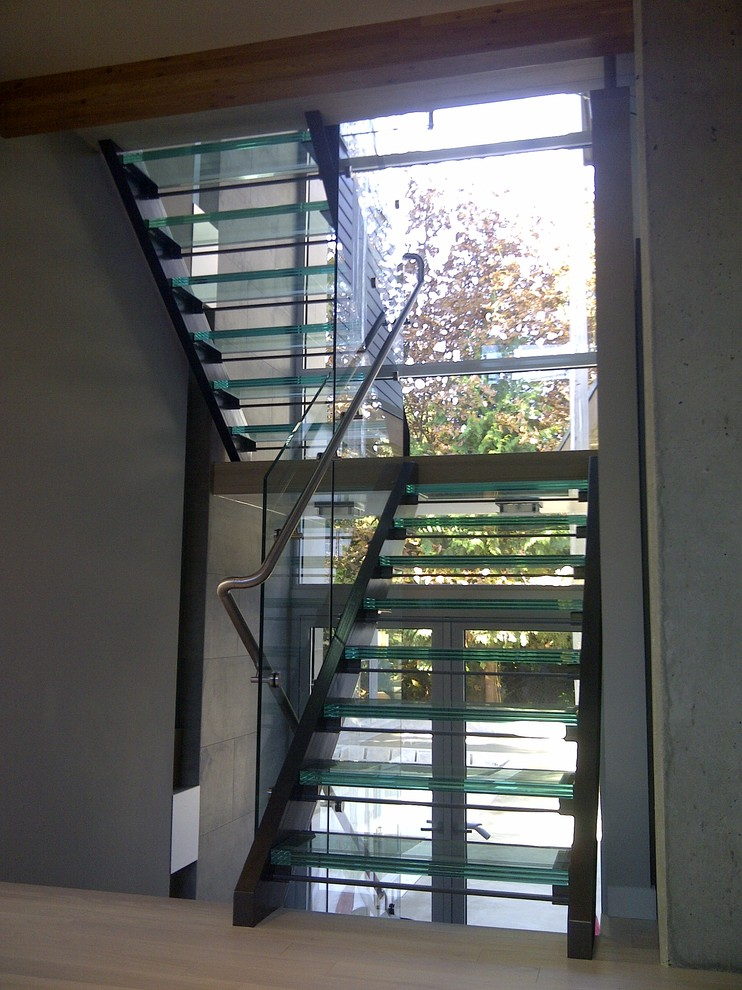 Example of a mid-sized trendy home design design in Vancouver