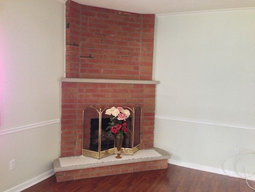 need help to update a red brick layered corner fireplace. Any suggestion and approx cost please