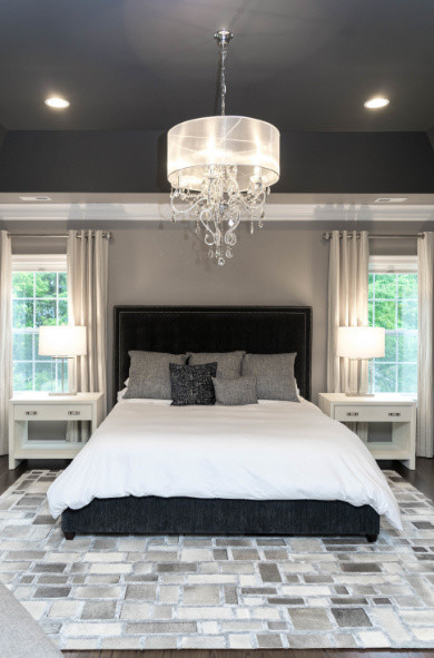 Example of a large transitional master dark wood floor and brown floor bedroom design in DC Metro with beige walls and no fireplace