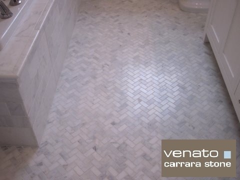 herringbone bathroom floor.  Floor tile