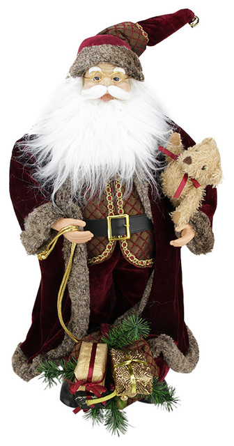 """24"""" Standing Santa In Long Burgundy Robe Holding A Teddy Bear And Gift Bag."""