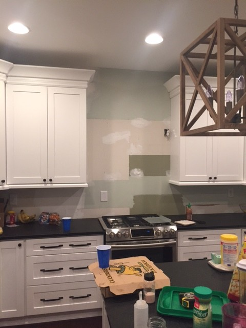 Where to stop subway tile if my cabinets don't go to ceiling?