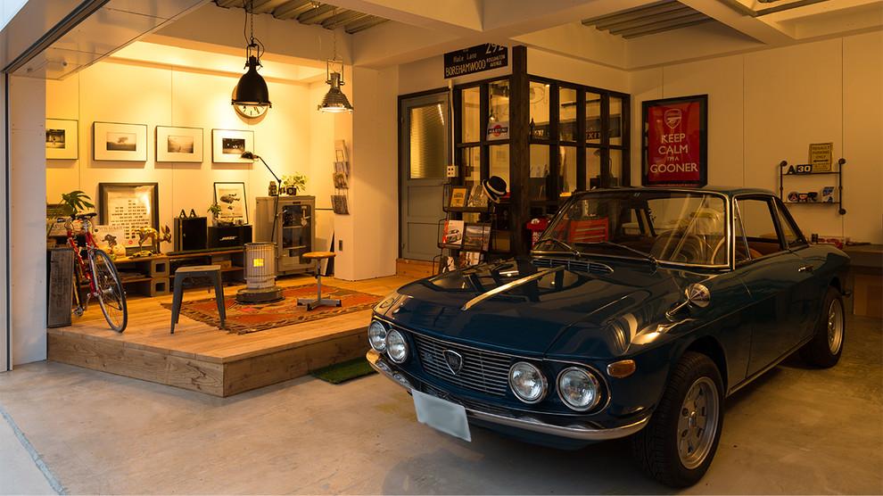 Garage - industrial one-car garage idea in Other
