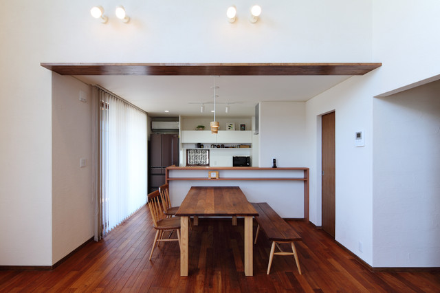 Inspiration for a contemporary dark wood floor and brown floor great room remodel in Other with white walls
