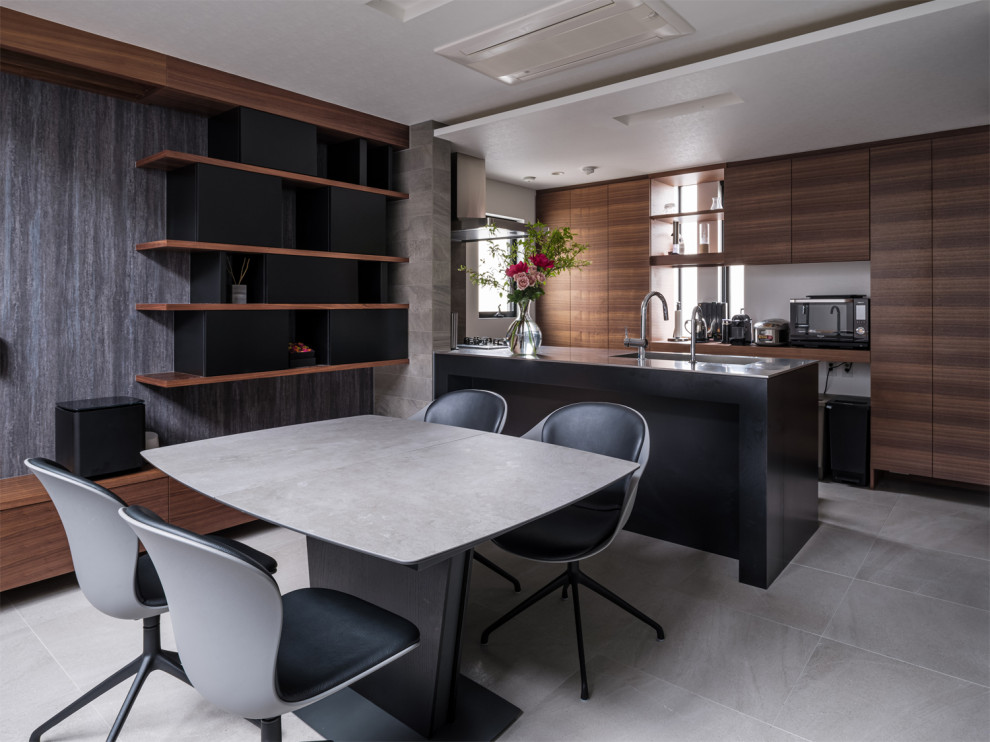 Trendy gray floor kitchen/dining room combo photo in Tokyo with gray walls