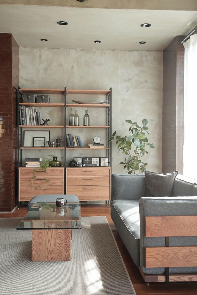 Danish medium tone wood floor and brown floor living room photo in Tokyo with gray walls
