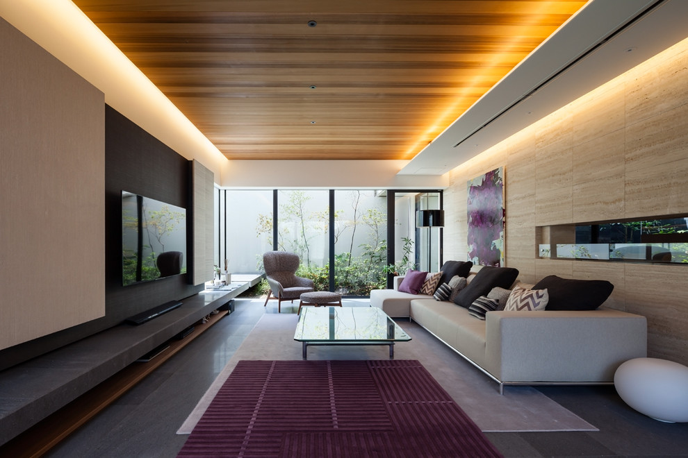 Living room - contemporary open concept gray floor living room idea in Kobe with beige walls and a wall-mounted tv