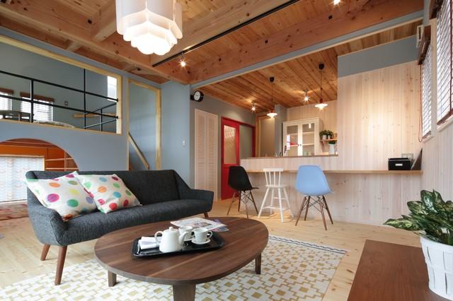 Living room - scandinavian light wood floor living room idea in Other with blue walls