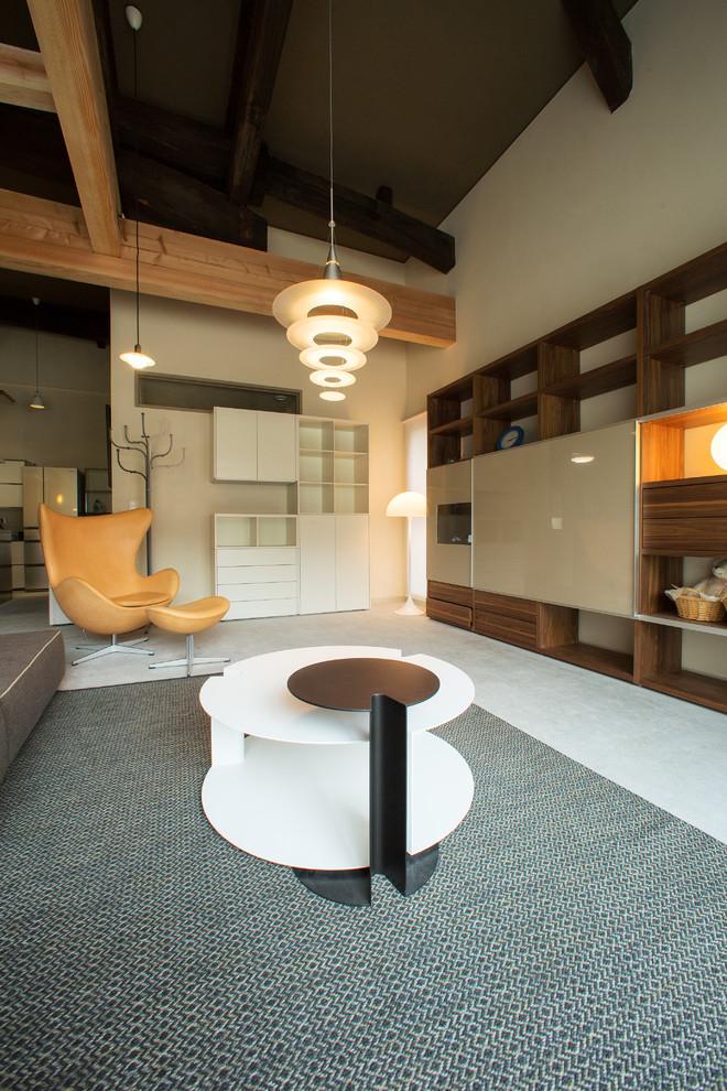 Imagen de salón contemporáneo con paredes beige