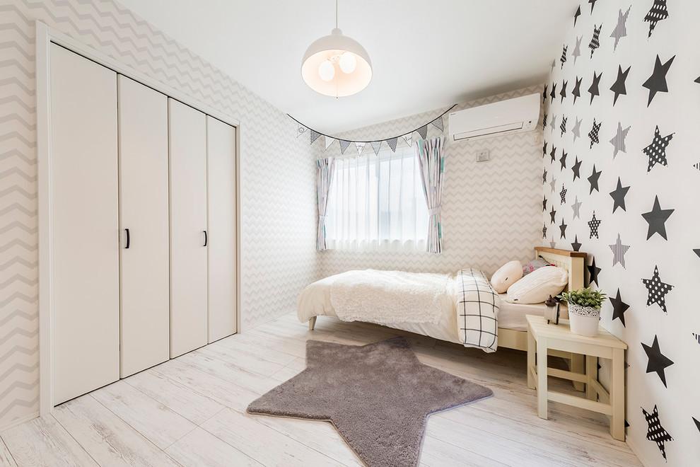 Kids' room - scandinavian gender-neutral light wood floor kids' room idea in Tokyo with multicolored walls