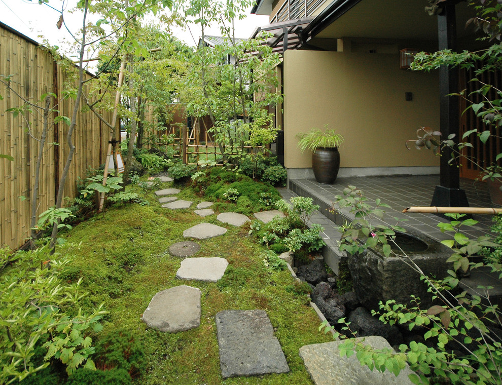 Design ideas for a mid-sized asian full sun front yard stone landscaping in Other for summer.