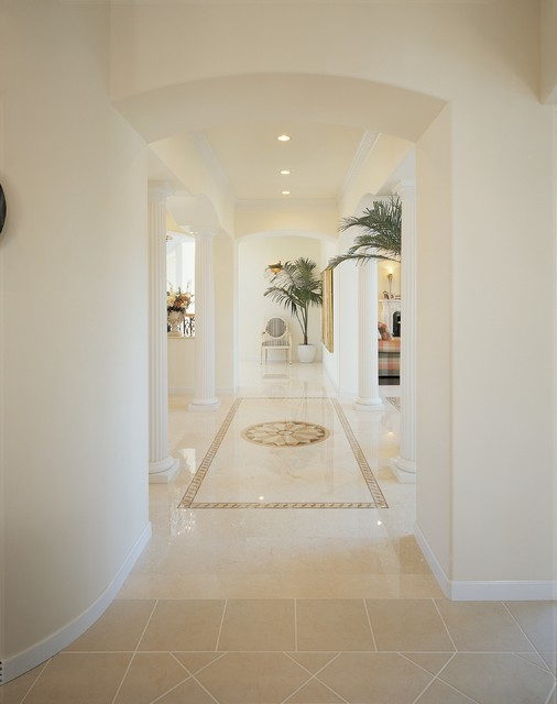 Huge tuscan marble floor and beige floor hallway photo in Other with white walls