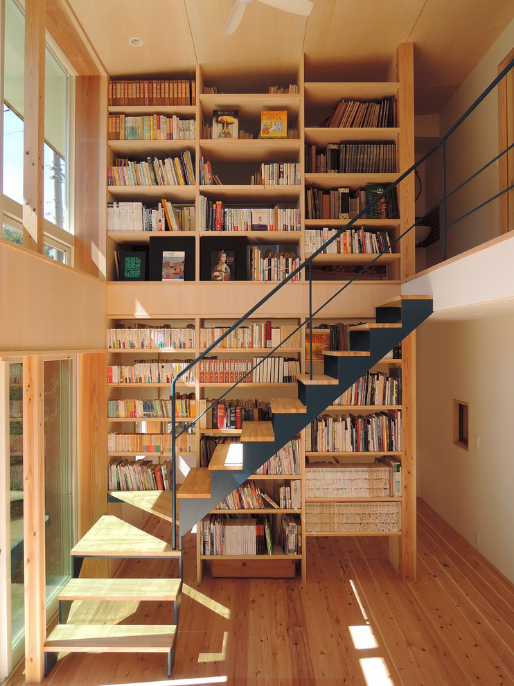 Small trendy wooden l-shaped open staircase photo in Other