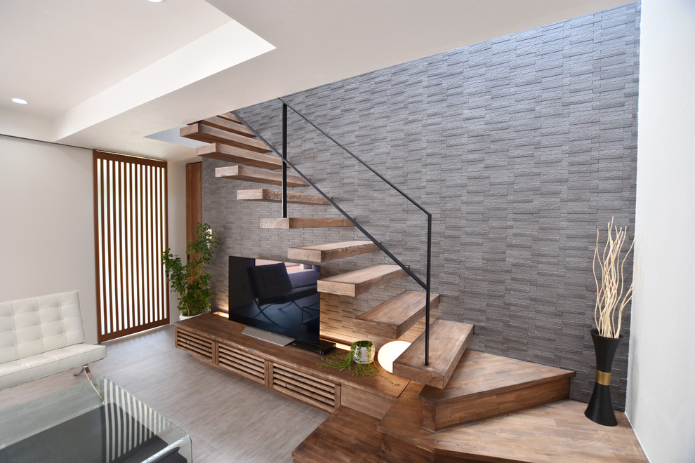 Inspiration for a modern wooden floating metal railing and open staircase remodel in Other