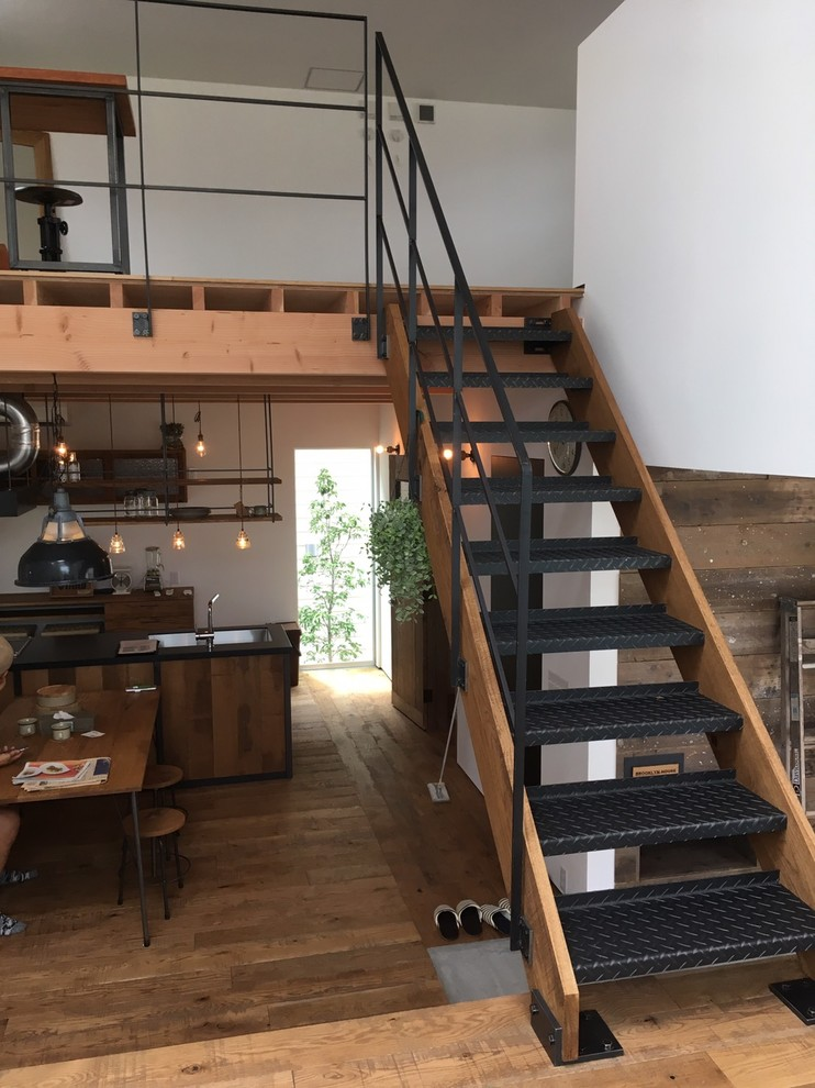 Inspiration for a small industrial straight open and metal railing staircase remodel in Other