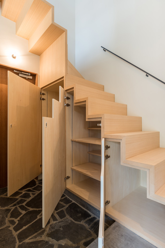 Staircase - contemporary wooden staircase idea in Other with wooden risers