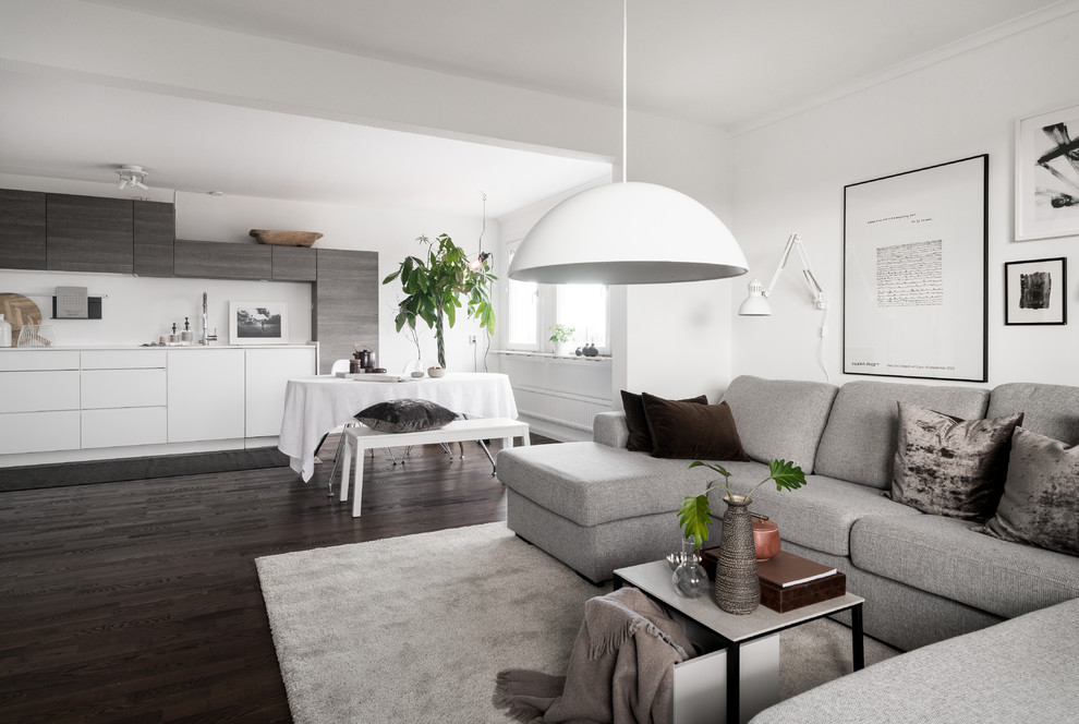 Design ideas for a medium sized scandi open plan games room in Stockholm with white walls, dark hardwood flooring and black floors.